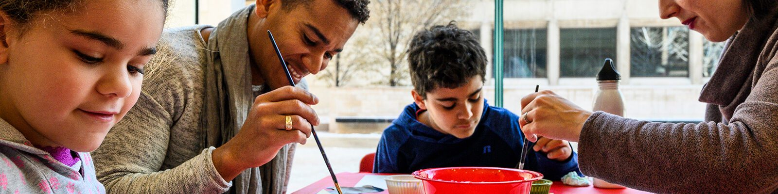 Family painting together at the Chazen Museum