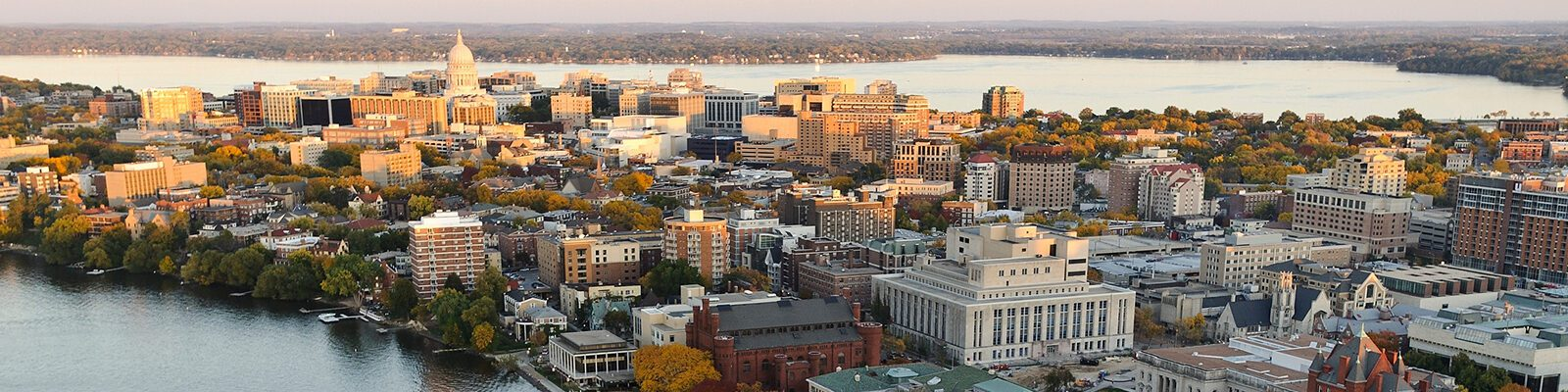 The Lake Mendota shoreline is pictured in an aerial view of the University of Wisconsin-Madison campus looking toward the downtown Madison skyline during an autumn sunset