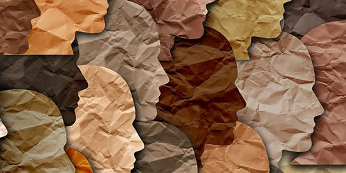Multi-cultural cutouts of faces.