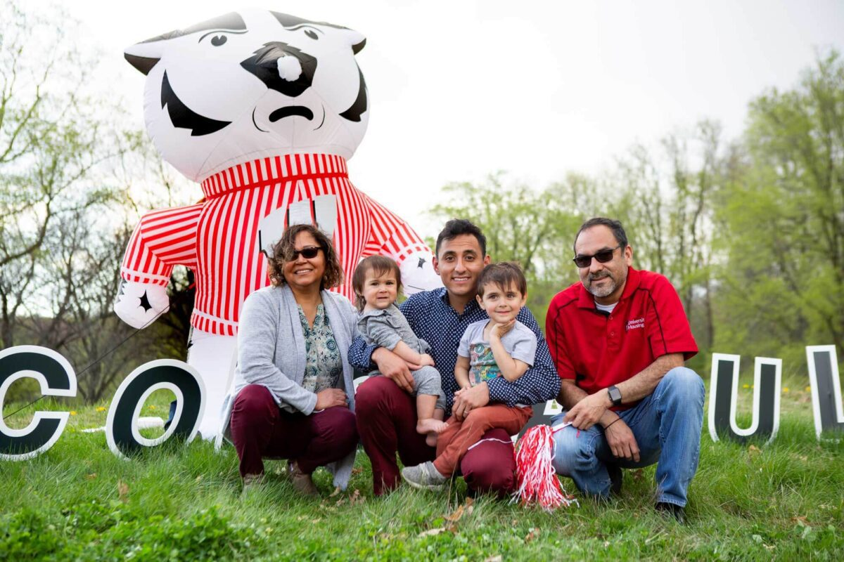 Jesus Garza Noriega and family in front of blowup Bucky Badger