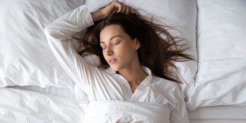 Woman sleeping peacefully with arm outstretched