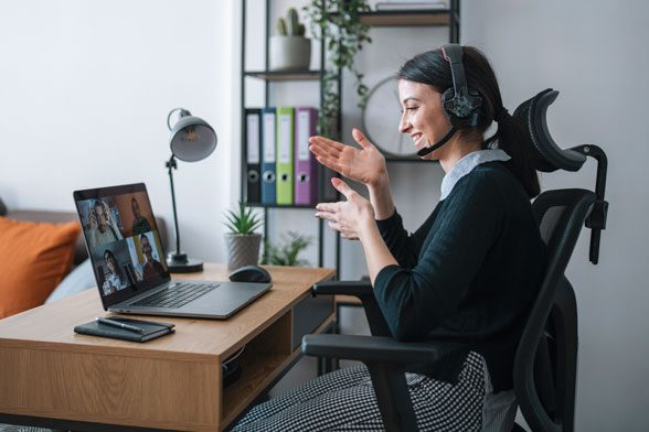 Woman leading online meeting from home office