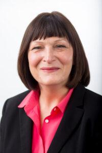Headshot of Janet Staker Woerner smiling