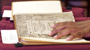 Holding History allows participants to handle archival Shakespeare materials.