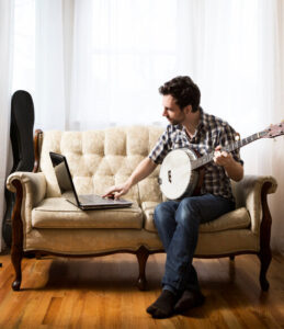 Man with Laptop and Banjo