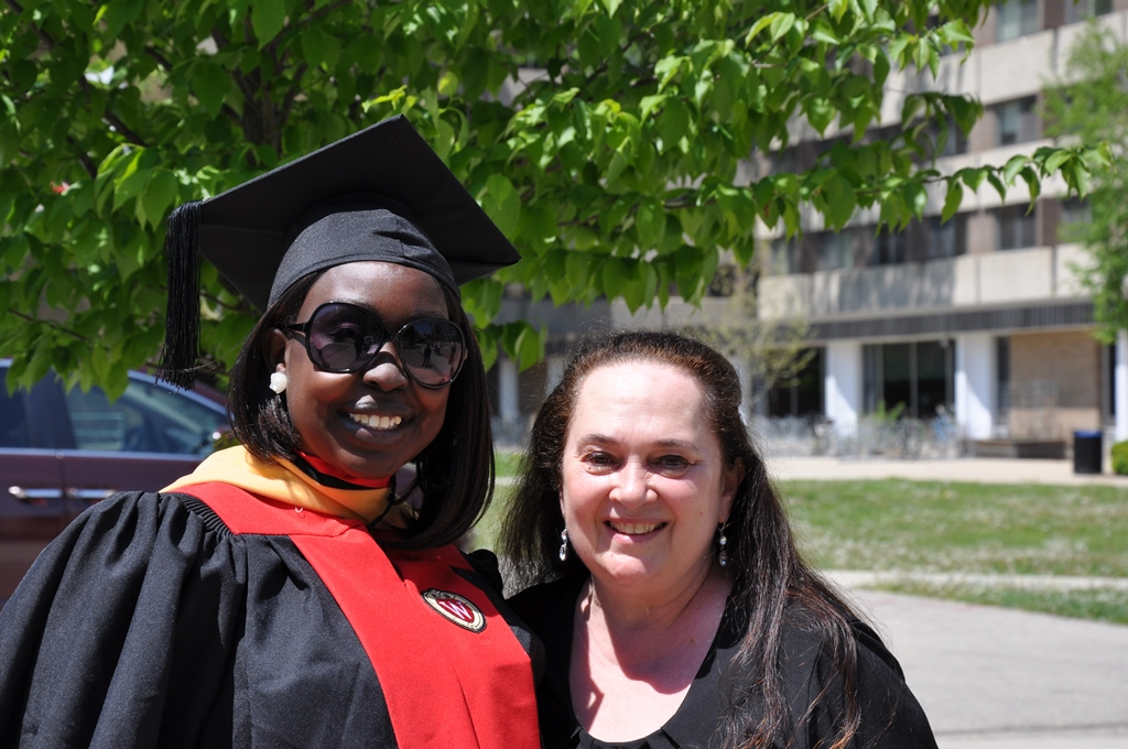 Master's student Josephine Lorya-Ozulamoi and Odyssey Project director Emily Auerbach celebrate completion of Josephine's master's in social work