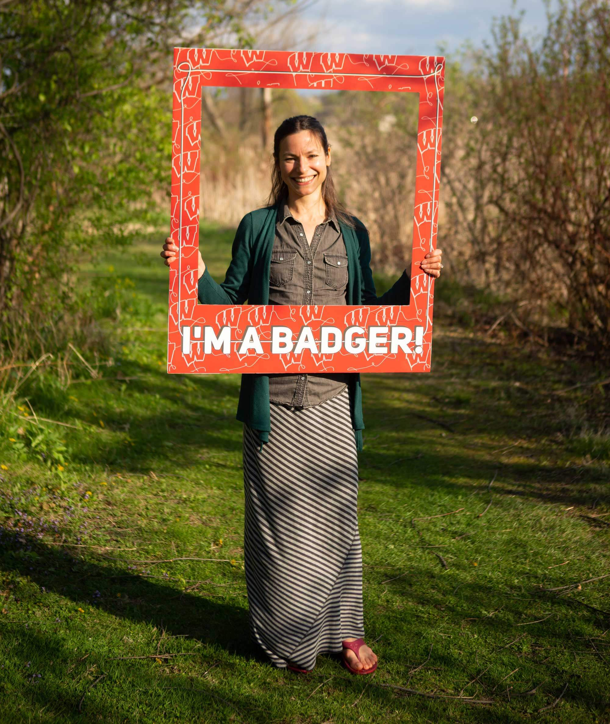 Student Janel Hutchison looking through a Bucky Badger frame