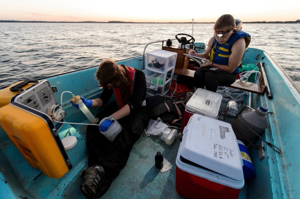 UW-Madison microbiology students on a boat on Lake Mendota