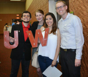A fun night at the International Student Graduation Celebration: VISP students Oliver Moura and Laura Faraci with coordinators Anna Seidel-Quast (second from left) and Josh Juedes (far right). Above: Award-winner Vinicius Sobral with furry friend.