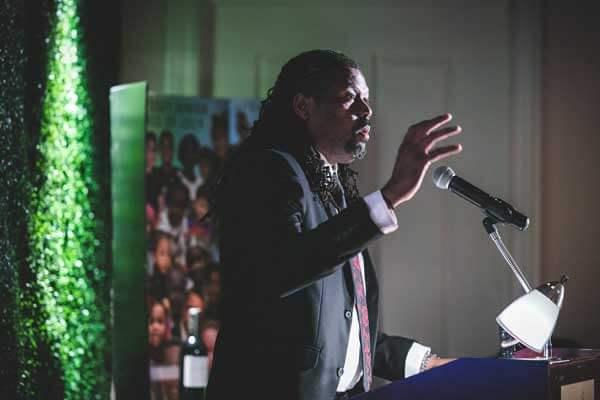 Odyssey graduate Corey Saffold speaking at the Odyssey gala