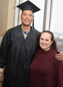 Brian Benford in cap and gown with Emily Auerbach