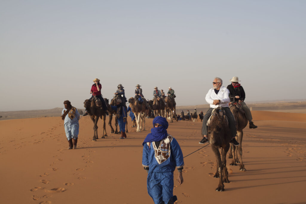 The group traversed coastlines, snowy mountains, stony plains, and desert sands.