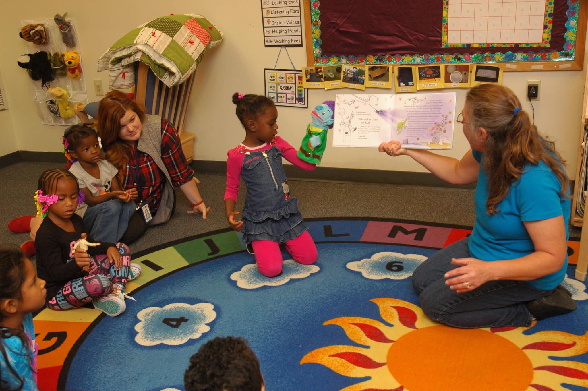 teacher reads to a class