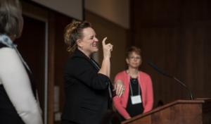 woman talking at podium