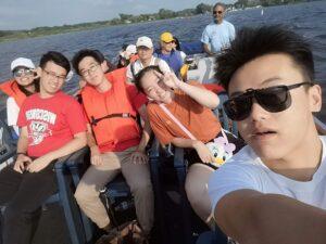 Chinese students enjoying a boat ride