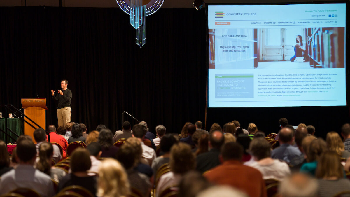 conference speaker with PowerPoint