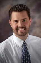 Headshot of Mark Bake smiling