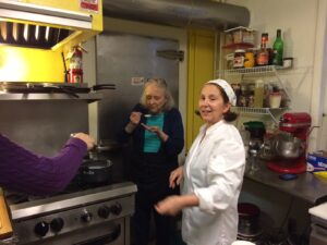 Chez Nanou's Anne-Marie Rieunier (right) helped the students cook and learn the relevant French terms.