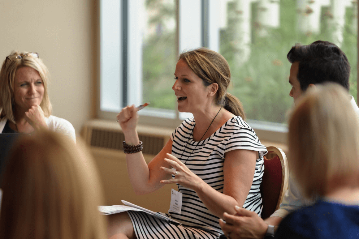 woman speaking to conference group