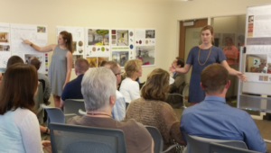 Students present their ideas to Office of the Registrar staffers.