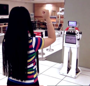 This robot helps you lose weight by exercising right beside you. Above: A telepresence robot allows you do navigate an environment from afar.