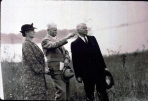 Jen Jensen points out to a woman and man a space of unbuilt land