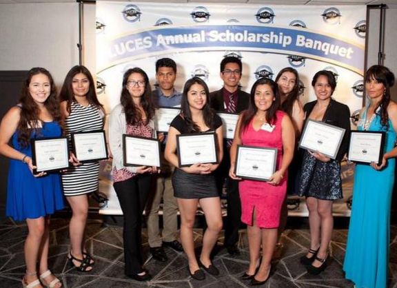 Latinos United for College Education Scholarships recognized promising Latino students at the Madison Concourse Hotel. Above: Emily Auerbach (left) with Odyssey Project grad Marisela Tellez-Giron.
