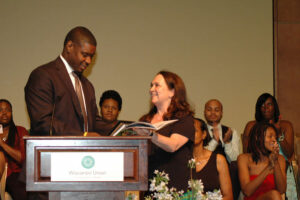 Emily Auerbach gives an award at the Odyssey Project graduation ceremony