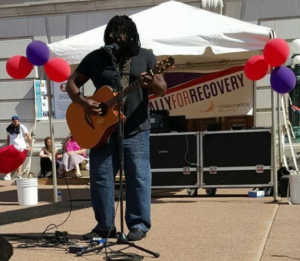 The event featured music, resource booths, a DJ, kids' activities, and speakers.