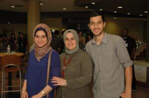 The Odyssey Project helps the Saeds (Umaima, Shaimaa, and Mustafa) improve their English while earning college credit. Above, front (left to right): Mustafa, Abdul, Shaimaa. Back: Umaima, Safaa.
