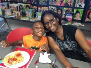 """Kelly Hayes and her son: """"With the right teachers and support staff, the sky is the limit for these kids."""" Above: Tai'Kiah Phillips and Eleita Florence also trained to become special education paraprofessionals."""